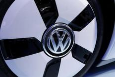 File photo of a Volkswagen logo on their XL 1 car during the media day at the Paris Mondial de l'Automobile, October 3, 2014. European new car sales rose 6.2 percent in October from year-ago levels as volume and premium leaders including the Volkswagen and BMW groups recorded stronger demand in key markets. Passenger-car registrations in the European Union (EU) and the countries of the European Free Trade Area (EFTA) increased to 1.113 million vehicles last month, from 1.047 million a year earlier, the Association of European Carmakers (ACEA) said November 18, 2014.    REUTERS/Jacky Naegelen  (FRANCE  - Tags: TRANSPORT BUSINESS)
