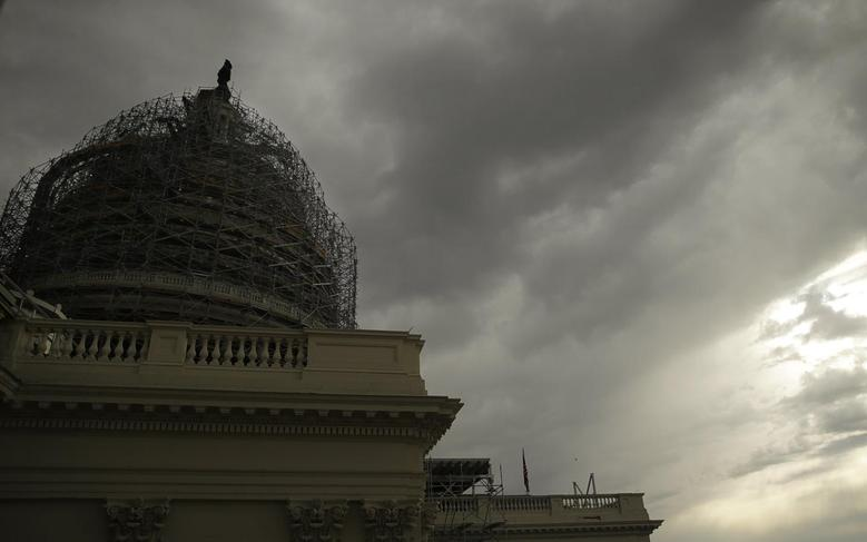 Storm clouds approach the U.S. Capitol dome during a day of rain in Washington November 6, 2014.   REUTERS/Gary Cameron