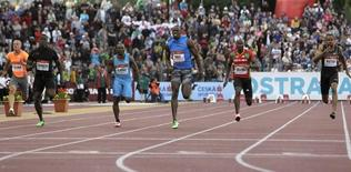 Jan Veleba of Czech Republic, Dwain Chambers of Britain, Lerone Clarke of Jamaica, his compatriot Usain Bolt, Kim Collins of Saint Kitts and Nevis and Darvis Patton of the U.S. (L-R) compete in the 100 meters men's race at the IAAF World Challenge Ostrava Golden Spike meeting in Ostrava May 25, 2012.        REUTERS/David W Cerny
