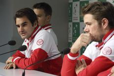 Switzerland's Davis Cup team player Roger Federer (L) and  teammate Stanislas Wawrinka attend a news conference at the Pierre Mauroy stadium in Villeneuve d'Ascq, northern France, November 18, 2014.   REUTERS/Pascal Rossignol