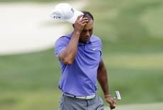 Tiger Woods of the U.S. reacts after finishing his play in the first round of the PGA Championship at Valhalla Golf Club in Louisville, Kentucky, August 7, 2014.  REUTERS/John Sommers II