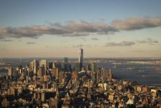 Lower Manhattan is seen just after sunrise from the observation deck of the Empire State Building in New York April 16, 2014. REUTERS/Brendan McDermid