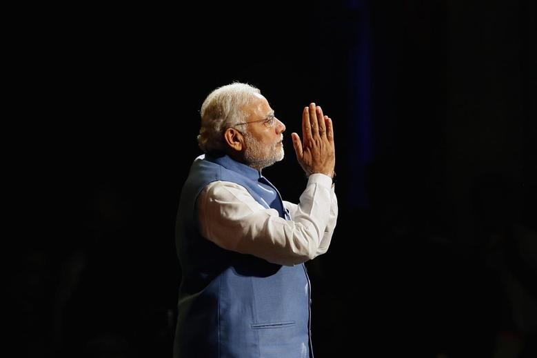 Prime Minister Narendra Modi reacts as he speaks to members of the Australian-Indian community during a reception at the Allphones Arena located at Sydney Olympic Park in western Sydney November 17, 2014. REUTERS/Rick Stevens