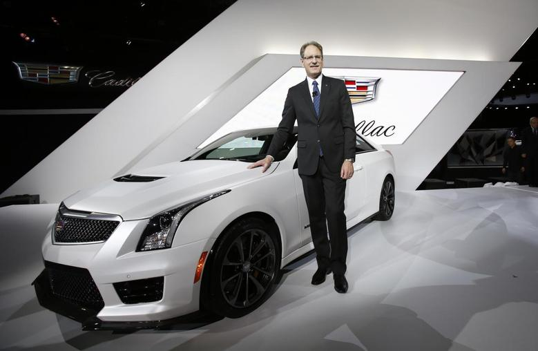 Cadillac President Johan de Nysschen poses with the Cadillac ATS-V during the model's world debut at the Los Angeles Auto Show in Los Angeles, California November 19, 2014.     REUTERS/Mario Anzuoni
