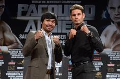 Sep 3, 2014; Los Angeles, CA, USA; Manny Pacquiao (left) and Chris Algieri pose at press conference at Hyatt Regency Century Plaza Hotel in advance of World Welterweight Championship bout on Nov. 22, 2014.  Kirby Lee-USA TODAY Sports