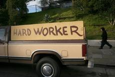 "A handmade sign painted on the side of a pickup truck reading ""hard worker"" is shown in San Francisco, California, January 25, 2009.  REUTERS/Robert Galbraith"