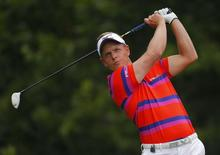 Luke Donald of England watches his tee shot on the sixth hole during the first round of the 2014 PGA Championship at Valhalla Golf Club in Louisville, Kentucky, August 7, 2014. REUTERS/Brian Snyder