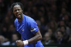 France's Gael Monfils reacts during their Davis Cup final singles tennis match against Switzerland's Roger Federer at the Pierre-Mauroy stadium in Villeneuve d'Ascq, near Lille, November 21, 2014.     REUTERS/Gonzalo Fuentes
