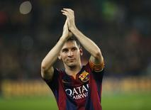 Barcelona's Lionel Messi celebrates at the end of their Spanish first division soccer match against Sevilla at Nou Camp stadium in Barcelona November 22, 2014. REUTERS/Albert Gea