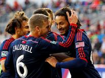Nov 23, 2014; Harrison, NJ, USA; New England Revolution midfielder Jermaine Jones (13) (right) is congratulated by midfielder Scott Caldwell (6) after scoring the game-winning goal in the 85th minute against the New York Red Bulls during the Eastern Conference Championship at Red Bull Arena. The Revolution defeated the Red Bulls 2-1. Mandatory Credit: Andy Marlin-USA TODAY Sports