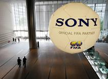 A large soccer ball-shaped installation promoting Sony Corp's partnership with FIFA is hung at Sony Corp's headquarters in Tokyo June 19, 2009. REUTERS/Kim Kyung-Hoon