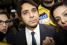 Canadian celebrity radio host Jian Ghomeshi leaves court after getting bail on multiple counts of sexual assault in Toronto November 26, 2014.  REUTERS/Peter Power