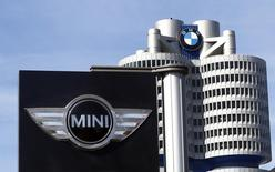The logo of German luxury car maker BMW-Mini is pictured in front of the BMW headquarters in Munich March 18, 2014. BMW will hold its annual news conference in Munich tomorrow.     REUTERS/Michael Dalder(GERMANY - Tags: TRANSPORT SPORT MOTORSPORT)