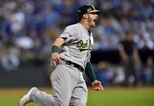 Sep 30, 2014; Kansas City, MO, USA; Oakland Athletics third baseman Josh Donaldson (20) reacts as he round third base on the three-run home run by designated hitter Brandon Moss (37) against the Kansas City Royals during the sixth inning of the 2014 American League Wild Card playoff baseball game at Kauffman Stadium.  Peter G. Aiken-USA TODAY Sports