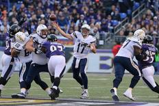 Nov 30, 2014; Baltimore, MD, USA; San Diego Chargers quarterback Philip Rivers (17) passes against the Baltimore Ravens at M&T Bank Stadium. Mandatory Credit: Mitch Stringer-USA TODAY Sports