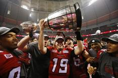 Calgary Stampeders' quarterback Bo Levi Mitchell holds the Grey Cup after the Stampeders defeated the Hamilton Tiger Cats in the CFL's 102nd Grey Cup football championship in Vancouver, British Columbia, November 30, 2014. REUTERS/Mark Blinch