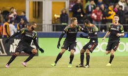 Los Angeles Galaxy midfielder Juninho (19) celebrates with his teammates after he scored against the Seattle Sounders FC during the second half of the Western Conference Championship at CenturyLink Field. Mandatory Credit: Joe Nicholson-USA TODAY Sports