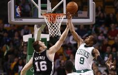 San Antonio Spurs forward Aron Baynes (16) shoots the ball against Boston Celtics guard Rajon Rondo (9) during the first half at TD Garden. Mandatory Credit: Mark L. Baer-USA TODAY Sports