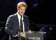 Britain's Prince Harry speaks at the opening ceremony of the Invictus Games at the Queen Elizabeth Park in east London September 10, 2014.REUTERS/Luke MacGregor