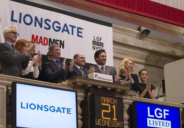 Chief Executive Officer of Lions Gate Entertainment, Jon Feltheimer (3rd L), at the New York Stock Exchange to ring the opening bell in New York, March 21, 2012.   REUTERS/Lucas Jackson