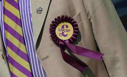 A supporter is seen wearing a United Kingdom Independence Party (UKIP) badge before meeting the leader of the party Nigel Farage, at a campaign event in South Ockendon, Essex in this May 23, 2014 file photo. REUTERS/Suzanne Plunkett/Files