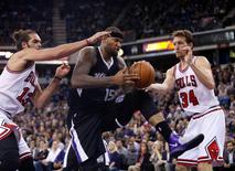 Nov 20, 2014; Sacramento, CA, USA; Sacramento Kings center DeMarcus Cousins (15) controls a rebound between Chicago Bulls center Joakim Noah (13) and forward Mike Dunleavy (34) during the fourth quarter at Sleep Train Arena. Mandatory Credit: Kelley L Cox-USA TODAY Sports
