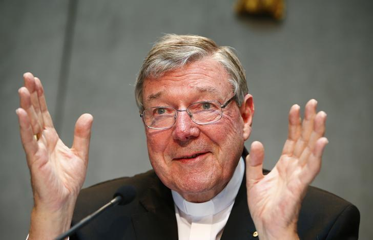 Cardinal George Pell gestures as he talks during a news conference for the presentation of new president of Vatican Bank IOR, at the Vatican July 9, 2014. REUTERS/Tony Gentile