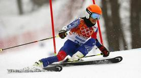 Vanessa Mae, competing for Thailand under her father's name Vanessa Vanakorn, skis during the first run of the women's alpine skiing giant slalom event at the 2014 Sochi Winter Olympics at the Rosa Khutor Alpine Center February 18, 2014.  REUTERS/Ruben Sprich