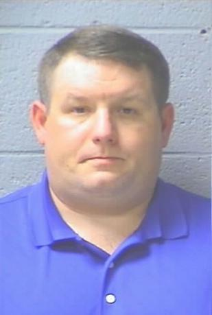 Richard Combs, a former Eutawville, South Carolina police chief, who was indicted by a grand jury in the 2011 shooting death of Bernard Bailey, is shown in this 2011 Orangeburg County Detention Center photo released on December 4, 2014. Combs has been indicted on a murder charge in the 2011 shooting death of a black man in the town hall parking lot, a county clerk's office said on Thursday.   REUTERS/Orangeburg County Detention Center