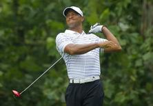 Tiger Woods of the U.S. grimaces after hitting his tee shot on the seventh hole during the second round of the 2014 PGA Championship at Valhalla Golf Club in Louisville, Kentucky, August 8, 2014. REUTERS/Brian Snyder