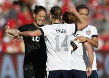 Goalkeeper Nicole Barnhart (L) of the U.S. celebrates with teammate Whitney Engen (14) after their team defeated Canada in their friendly women's soccer match in Toronto, June 2, 2013. REUTERS/Mark Blinch
