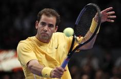 Tennis legend Pete Sampras hits a return to fellow legend Andre Agassi during their exhibition match at the BNP Paribas Showdown at Madison Square Garden in New York February 28, 2011.  REUTERS/Mike Segar