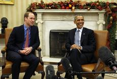 U.S. President Barack Obama (R) meets Britain's Prince William in the Oval Office of the White House in Washington December 8,  2014.  REUTERS/Kevin Lamarque