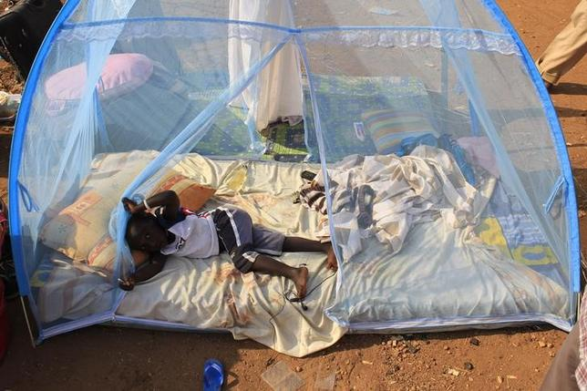 Reuters caption:  A displaced child plays on a mattress under a mosquito net laid in the open at Tomping camp near South Sudan's capital Juba January 7, 2014. Reuters/James Akena/Files
