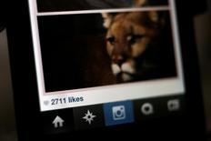 Instagram, le service de partage de photos racheté par Facebook, dit avoir franchi le cap des 300 millions d'utilisateurs, avec plus de 70 millions de clichés et de vidéos échangés chaque jour. /Photo d'archives/REUTERS/Mario Anzuoni