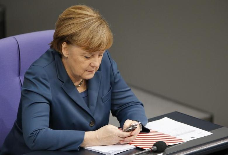 German Chancellor Angela Merkel uses a Nokia slide mobile as she attends a session of the lower house of parliament, the Bundestag in Berlin, November 28, 2013.     REUTERS/Fabrizio Bensch