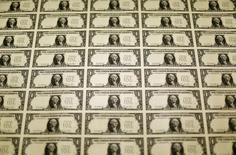 A sheet of the front side of United States one dollar bills is seen during production at the Bureau of Engraving and Printing in Washington November 14, 2014.   REUTERS/Gary Cameron