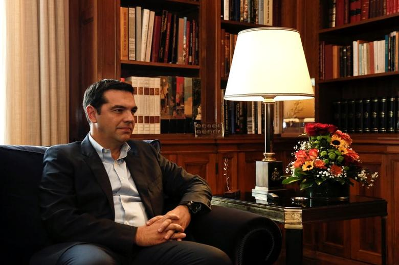 Alexis Tsipras, leader of Greece's far-left Syriza party listens to Greek President Karolos Papoulias (not pictured) during their meeting at the Presidential palace in Athens November 3, 2014.  REUTERS/Yorgos Karahalis
