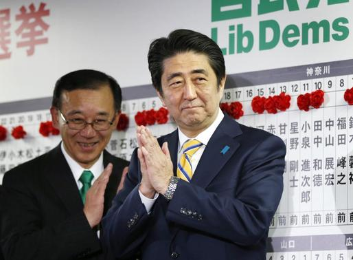 Japan's Prime Minister Shinzo Abe, who is also leader of the ruling Liberal Democratic Party (LDP), claps during an election night event at the LDP headquarters in Tokyo, December 14, 2014.    REUTERS/Toru Hanai