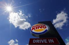 The logo of a Burger King fast food outlet is seen at the chain's drive-through branch in Hanau, August 29, 2014.     REUTERS/Kai Pfaffenbach