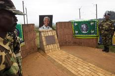 African National Congress members visit the arrest site of of former South African President Nelson Mandela on the anniversary of his death in Howick, December 5, 2014. REUTERS/Rogan Ward