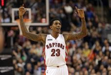 Toronto Raptors guard Lou Williams (23) celebrates a basket against the Milwaukee Bucks at Air Canada Centre. The Raptors beat the Bucks 124-83. Mandatory Credit: Tom Szczerbowski-USA TODAY Sports