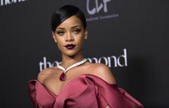 Singer Rihanna poses at the First Annual Diamond Ball fundraising event at The Vineyard in Beverly Hills, California December 11, 2014. REUTERS/Mario Anzuoni