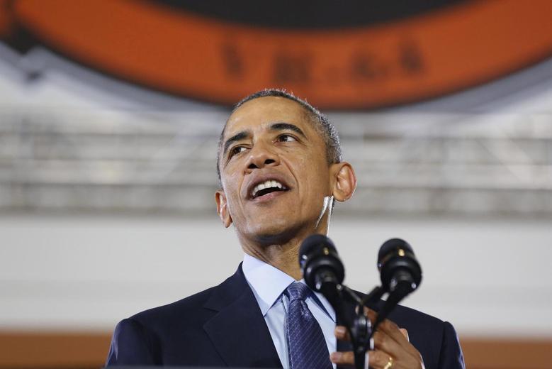 U.S. President Barack Obama speaks at Joint Base McGuire-Dix-Lakehurst in New Jersey, December 15, 2014.        REUTERS/Larry Downing