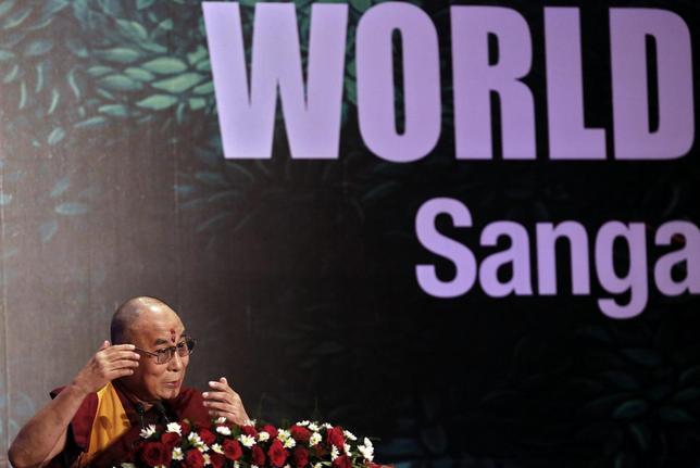 Exiled Tibetan spiritual leader, the Dalai Lama, speaks during the World Hindu Congress 2014 conference in New Delhi November 21, 2014. REUTERS/Anindito Mukherjee