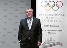 International Olympic Committee (IOC) President Thomas Bach smiles following a news conference as part of the IOC Executive Board meeting in Monaco December 6, 2014. REUTERS/Eric Gaillard