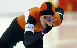 Irene Wust of the Netherlands competes in the women's 1,000 metres speed skating event during the 2014 Sochi Winter Olympics, February 13, 2014.       REUTERS/Marko Djurica