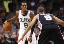 Boston Celtics guard Rajon Rondo (9) dribbles the ball against San Antonio Spurs guard Tony Parker (right) during the first half at TD Garden. Mandatory Credit: Mark L. Baer-USA TODAY Sports