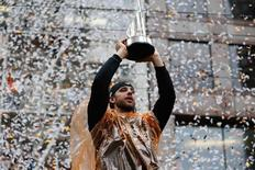 San Francisco Giants starting pitcher Madison Bumgarner (40) holds up his MVP trophy during the World Series victory parade on Market Street. Kelley L Cox-USA TODAY Sports