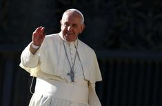 Pope Francis, waves as he leaves at the end of his general audience in Saint Peter's Square at the Vatican, December 17, 2014. REUTERS/Tony Gentile